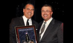 Honoree Rocky Delgadillo received his award from former City Attorney Nuch Trutanich.