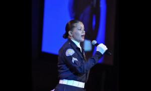 LAPD officer Roslyn Curry sang the national anthem.