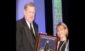 "SAG-AFTRA President and actor Ken Howard accepts the ""In the Line of Duty"" award from special guest presenter Gabrielle Carteris, SAG-AFTRA executive vice president."